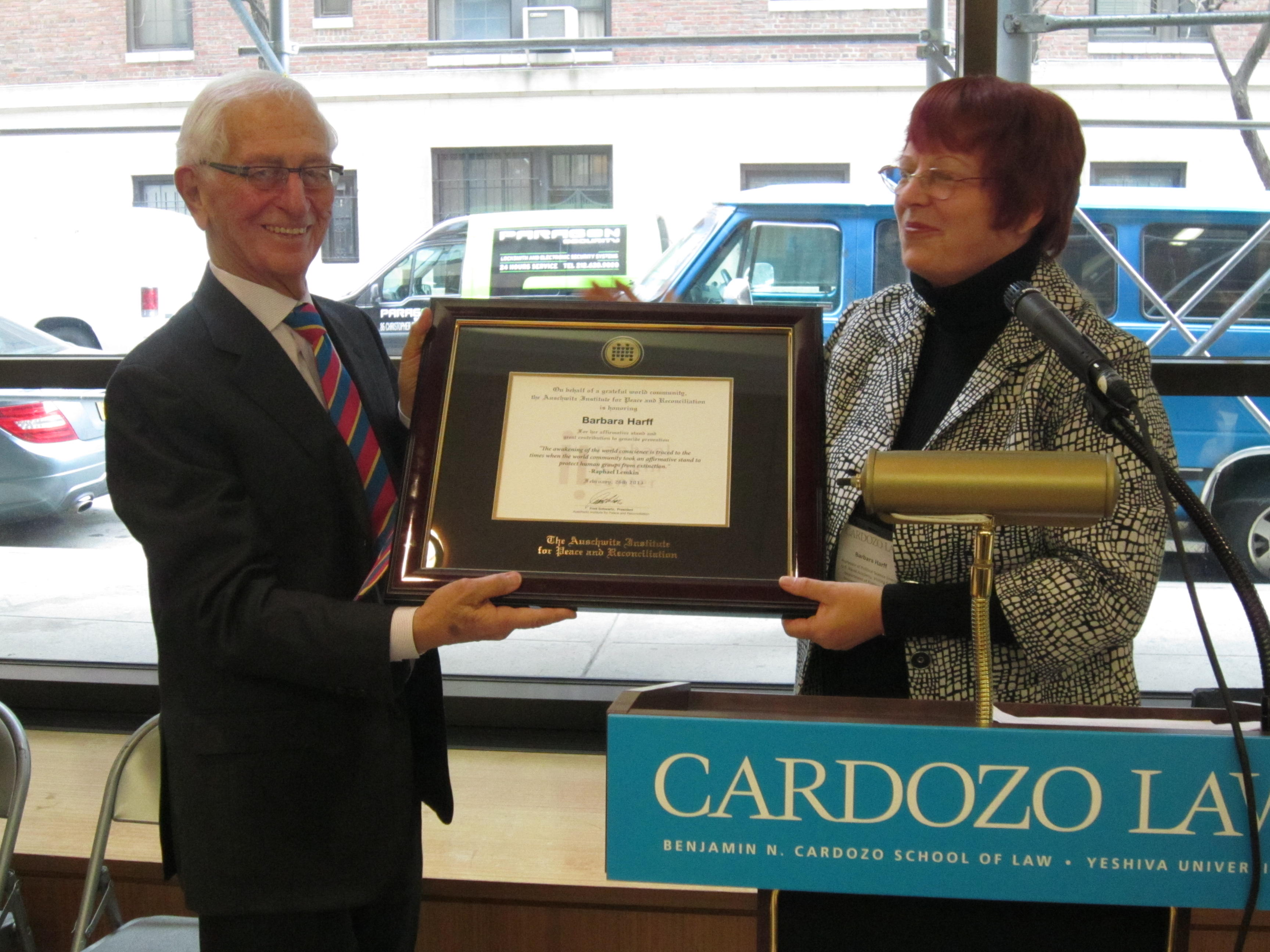 Barbara Harff accepts Raphael Lemkin Prize from Auschwitz Institute president Fred Schwartz